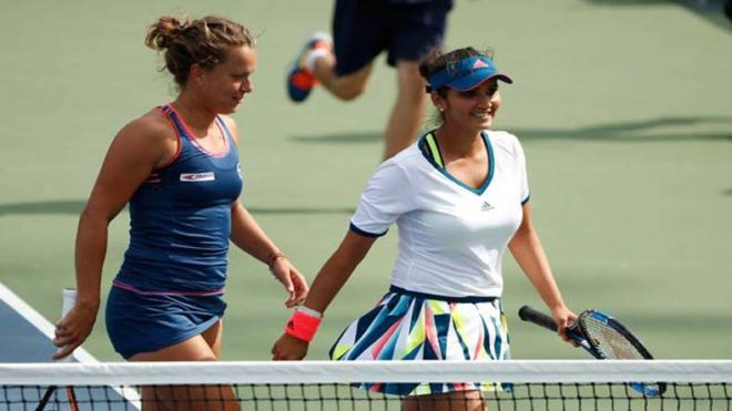 Indian tennis ace Sania Mirza and doubles partner Strycova ease into second round