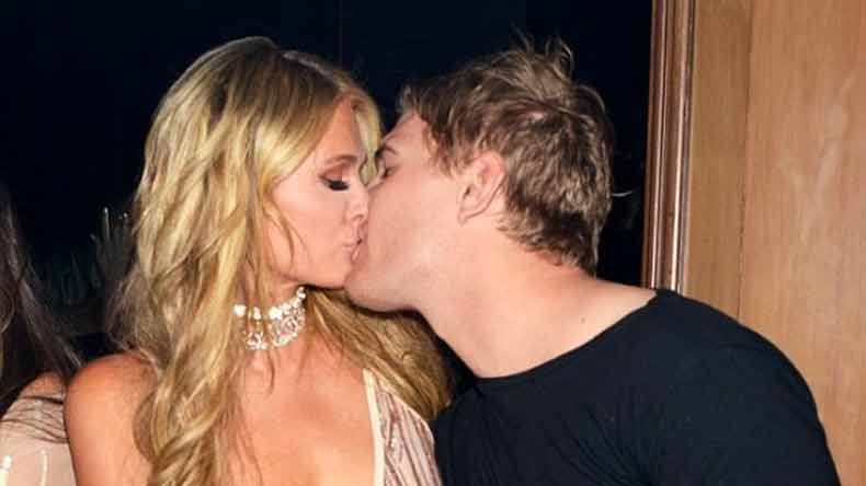 Paris Hilton caught locking lips with new beau