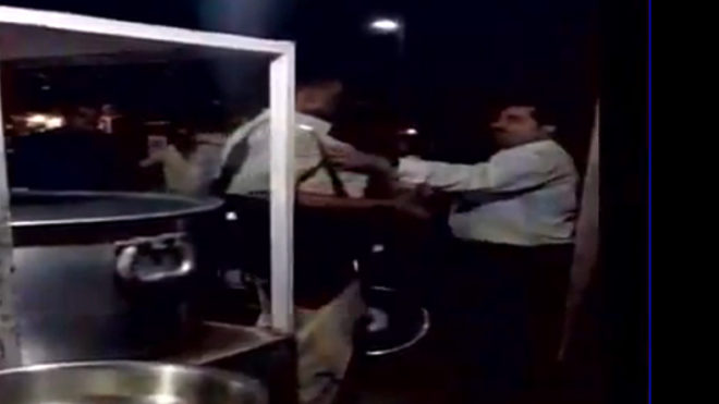 The hazy 33-second clip shows a policeman in uniform standing alone as unidentified man advances and grasps the policemen by his collar to evoke the assault.