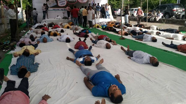 Farmers perform Shavasana on road in Mirzapur district