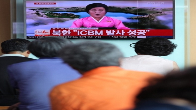 Seoul: People watch a live TV report at Seoul Station on July 4, 2017, showing North Korea's special announcement that it has successfully tested an intercontinental ballistic missile. (Yonha/IANS)