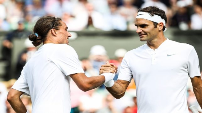 LONDON, July 5, 2017 (Xinhua) -- Switzerland's Roger Federer (R) shakes hands with Ukraine's Alexandr Dolgopolov after their men's singles first round match at the Championship Wimbledon 2017 in London, Britain, on July 4, 2017. Federer advanced to the second round after Dolgopolov retired due to injury. (Xinhua/Tang Shi/IANS)