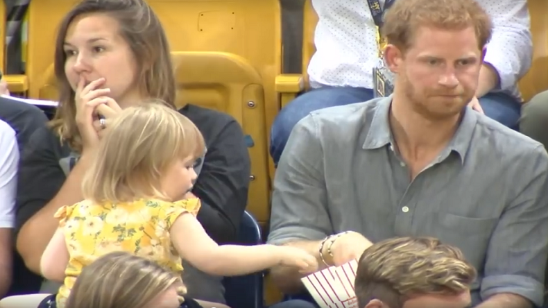 Watch Prince Harry's adorable moments with baby girl as she'steals his popcorn