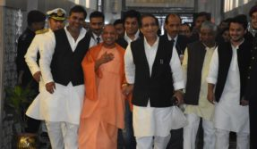 Arch political rivals UP CM Yogi Adityanath and SP leader Azam Khan seen walking hand-in-hand inside UP Assembly