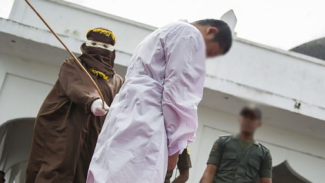 Gay couple sentenced to caning in Indonesian