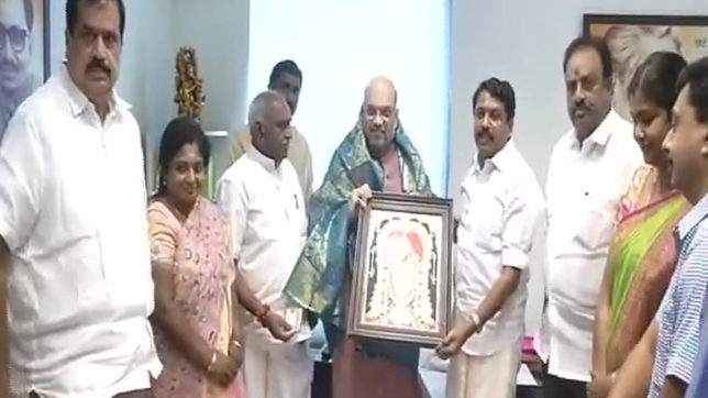 15 AIADMK MLAs join BJP in presence of Amit Shah