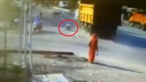Gujarat,Truck,Caught on Camera,man hit by truck,Godhra,godhra accident,Accident caught on CCTV,Truck accident. offbeat news,