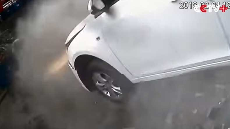 China: Car tumbles down two floors, driver and co-passenger have narrow escape