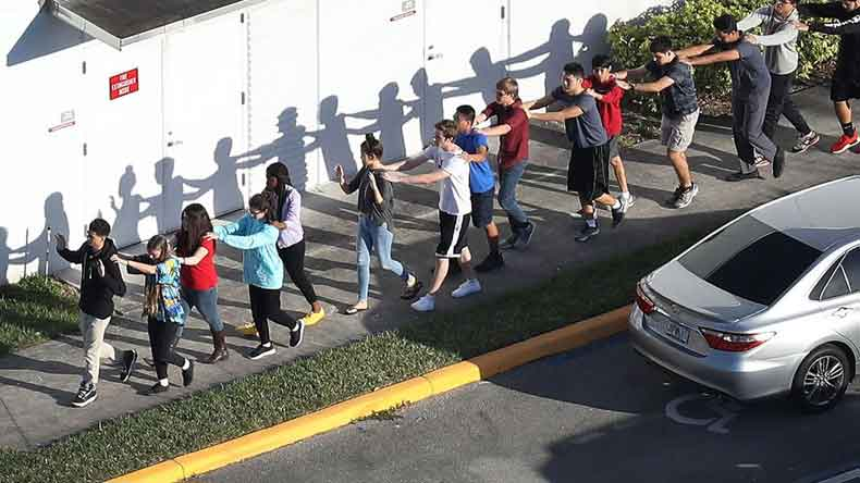 Florida school shooting: 17 dead, more than a dozen injured after former student opens fire