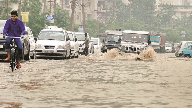 Heavy rain lashes Delhi-NCR, road caves in, waterlogging leads to traffic-jams