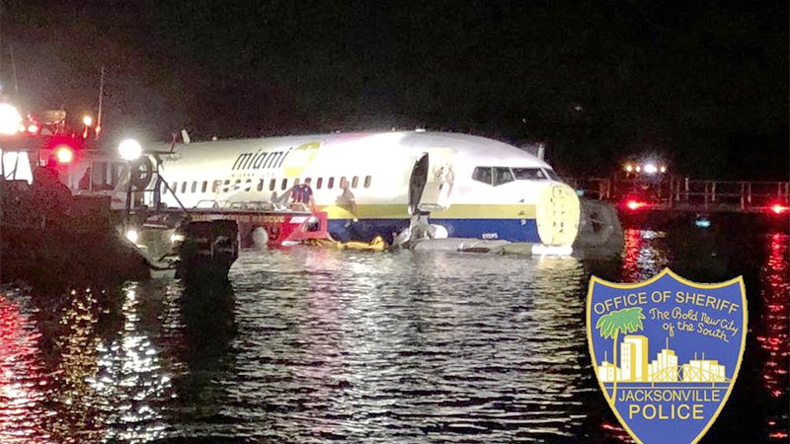 In this photo released by the Jacksonville Sheriff's Office, authorities work at the scene of a plane in the water in Jacksonville, Florida on Friday, May 3, 2019.